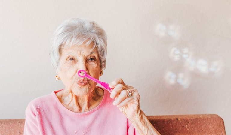 95 year old woman blowing bubbles
